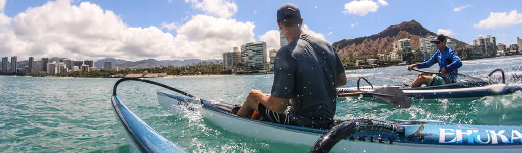 Jimmy Austin and Johnnie Puakea paddle Ehukai OC1 canoes as they prepare for the Kaiwi Channel OC1 Championship