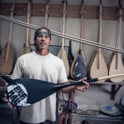 Cameron Jacome holding the New Edition Palafamala Ozone Built, at his shop in Lahaina Maui